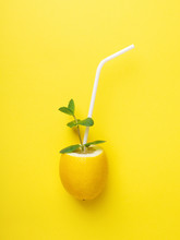 Lemon With White Straw And Mint.