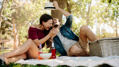 Papiers peints Couple in love enjoying on a picnic