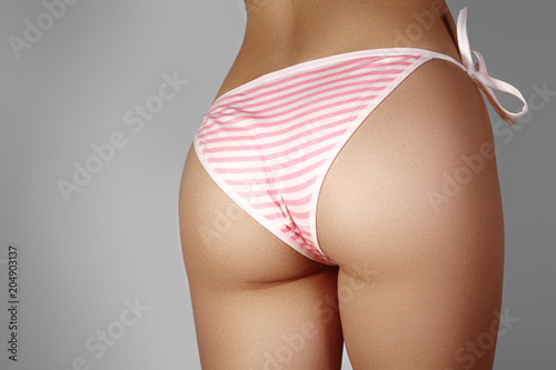 Close-up view of Female Sport Tanned Buttocks in Sexy Pink Panties Canvas Print