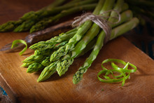 Green Asparagus On Wooden Plate