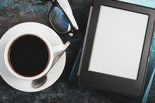 E-book And Paper Books On The Table With A Cup Of Coffee, A Laptop And Reading Glasses. Concepts Of Self-education.