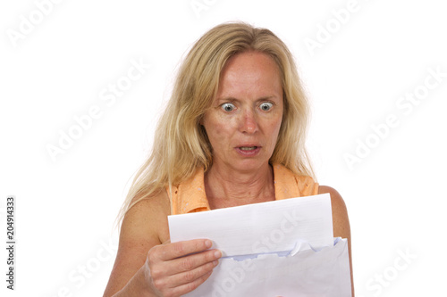 Photo An expensive bill in the mail, shocked woman.