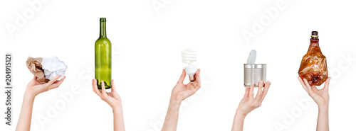 Fotografía  Hands holding crumpled paper, bulb, glass and plastic bottles, tin can isolated on white background