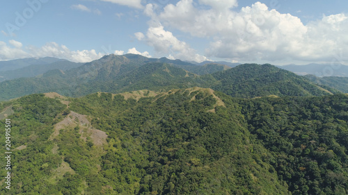 Foto op Plexiglas China Aerial view of mountains covered with green forest, trees with blue sky. Slopes of mountains with tropical forest. Philippines, ,Luzon. Tropical landscape in Asia.
