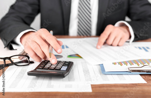 Businessman working with using a calculator to calculate the numbers Canvas Print