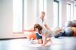 Leinwanddruck Bild - Senior physiotherapist working with a female patient.
