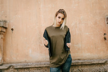 Beautiful Young Blonde Girl  In A Blank Green Military T-shirt And Leather Jacket  With Jeans