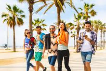 Happy Friends On Seaside Walk In Barcelona