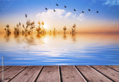 Fotografering  relajante amanecer en el lago