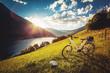Leinwandbild Motiv e-bike above a beautiful lake