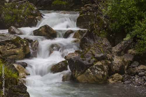 Foto op Canvas Rivier Fast mountain river at summer