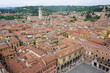 View of buildings and roofs in the old city of Verona, Italy, seen from the top of the Torre dei Lamberti tower