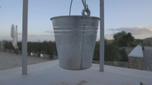 Close Up, Bucket Hangs On Balc...