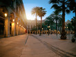 Sun rises over illuminated Plaza Real in in Gothic quarter of Barcelona, Spain