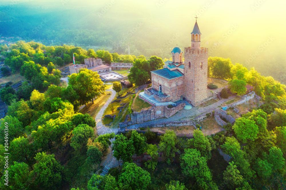 Fototapeta Aerial sunrise view of Tsarevets Fortress in Veliko Tarnovo in a beautiful summer day, Bulgaria 2018