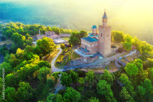 Fototapeta Aerial sunrise view of Tsarevets Fortress in Veliko Tarnovo in a beautiful summer day, Bulgaria 2018 obraz