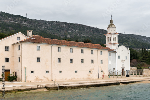 Staande foto Oude gebouw Saint Paul Monastery in Cres on a cloudy day in spring