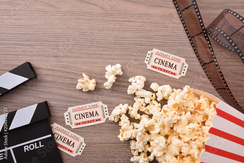 Equipment and elements of cinema on wood table top closeup