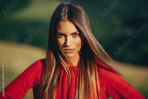 Portrait of a beautiful young woman in nature Fotobehang