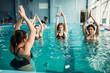 Leinwanddruck Bild - Female group on aqua aerobics in swimming pool