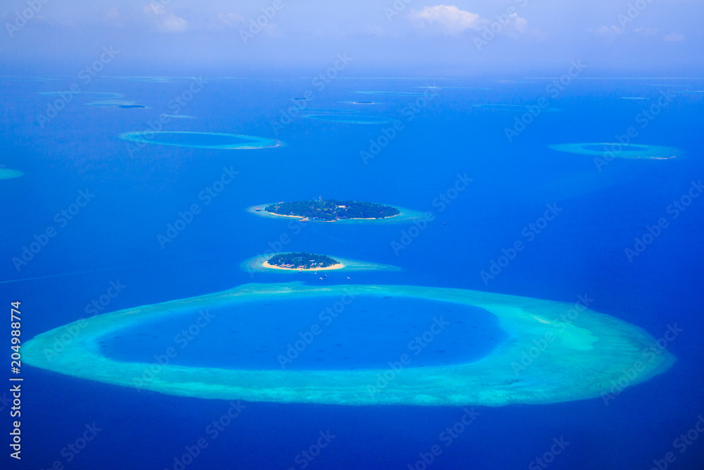 Fototapeta Amazing aerial view on the islands and atoll from above
