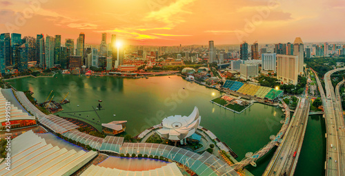 Panorama of Singapore Marina Bay with Financial District skyscrapers at sunset light reflected on the harbor. Roof top with Singapore skyline. Singapore cityscape aerial view.
