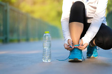 Young Fitness Woman Legs Walking In The Park Outdoor, Female Runner Tying Running Shoes, Asian Girl Jogging And Exercise On Footpath In Sunlight Morning. Healthcare And Well Being Concepts