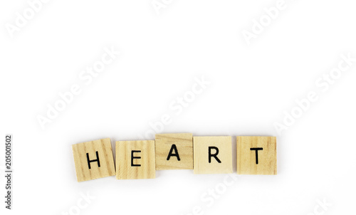 Fotografie, Obraz  Wooden tiles spelling out the word heart on an isolated white background