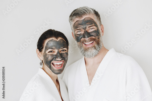 Fotografie, Obraz  Happy couple wearing a charcoal mask