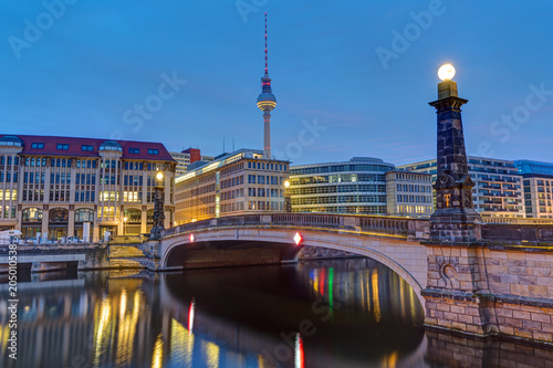 Fotobehang Tokyo Historic bridge over the river Spree in Berlin at dawn with the Television Tower in the back