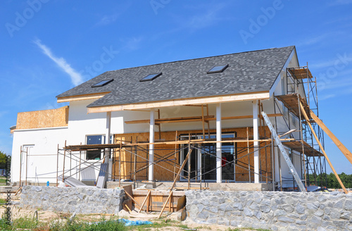 Tela Renovation house with asphalt shingles roofing construction, painting wall, stucco, wall repair, attic insulation, attic skylight windows