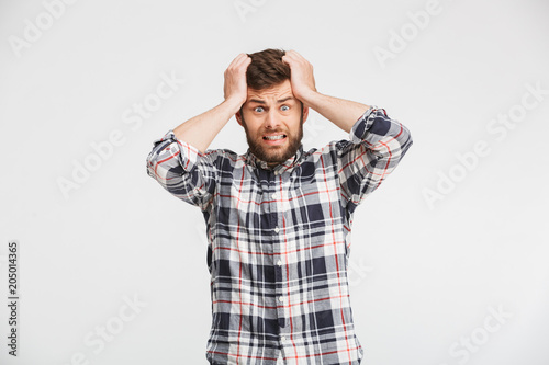 Portrait of a shocked young man looking at camera Canvas Print