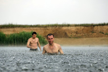 Two Young Man Are In A River U...