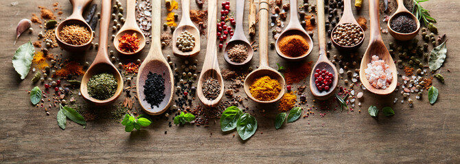 Herbs and spices on wooden board
