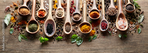 Printed kitchen splashbacks Spices Herbs and spices on wooden board