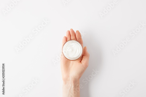 Fototapeta  cropped image of woman holding organic cream in container