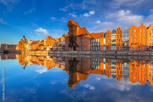 obraz PCV Historic port crane of Gdansk reflected in Motlawa river at sunrise, Poland
