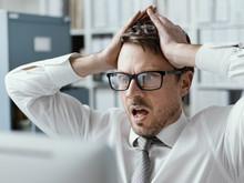 Panicking Businessman Receiving Bad News