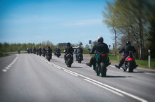 Column Of Bikers Riding On The Road.