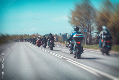 Column of bikers riding on the road. Canvas Print