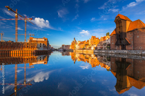 Poster Europa Historic port crane of Gdansk reflected in Motlawa river at sunrise, Poland