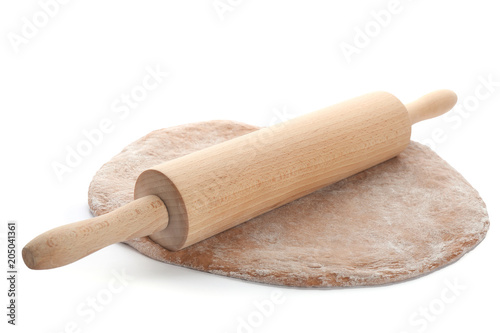 Raw rye dough and rolling pin on white background Poster