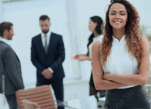 Fotobehang Stof beautiful woman on the background of business people.