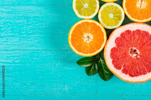 Fotografie, Obraz  Sliced grapefruit, oranges and lemon
