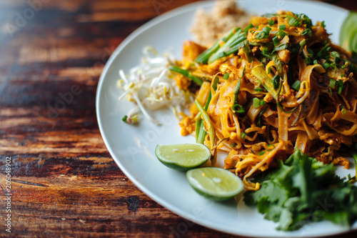 Fotografie, Obraz  Close up Padthai noodle with smoke tofu and mixed vegetable - wheat germs,lime,cucumber,parsley