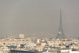 Fototapeta Fototapety Paryż - Aerial view of the Eiffel tower in the fog in Paris. City air pollution concept