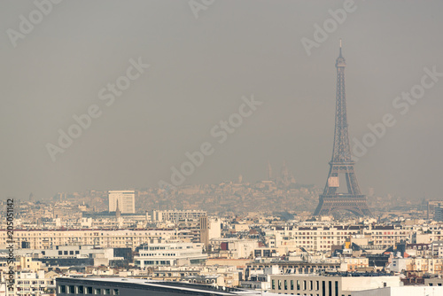 obraz lub plakat Aerial view of the Eiffel tower in the fog in Paris. City air pollution concept