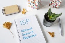 ISP Internet Service Provider Written In Notebook On White Table