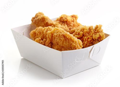Fototapeta Fried breaded chicken fillet in white cardboard box isolated obraz