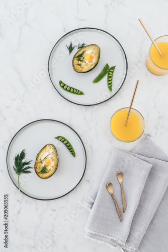 Keuken foto achterwand Eten Baked avocado with egg, sugar snaps and dill.
